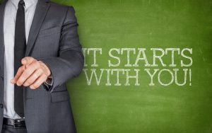 60224566 - it starts with youon blackboard with businessman finger pointing
